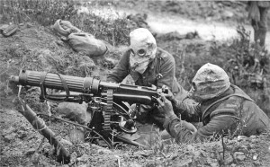 Vickers machine gun crew wearing gas mask (Wikipedia)