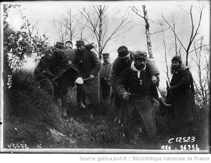 French soldiers carrying wounded comrades in the Argonnes, 1915